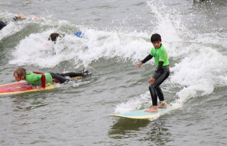 Children learning to surf in Cornwall